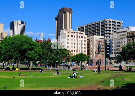 Church Square Pretoria city Gauteng South Africa square lawn people skyline high-rise buildings park center centre - Stock Photo