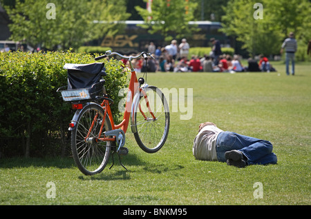 A man and a bicycle on the lawn in front of the Reichstag, Berlin, Germany - Stock Photo