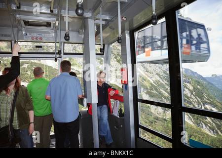 Obertraun, Salzkammergut, Austria. People inside the Dachstein World Heritage Cableway cablecar up to Krippenstein - Stock Photo
