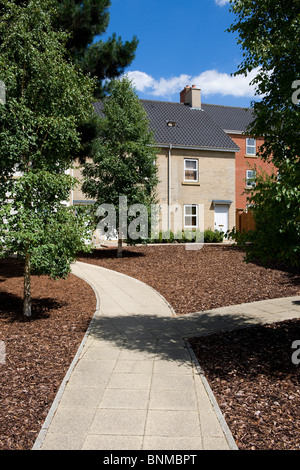 modern housing development and urban garden - Stock Photo