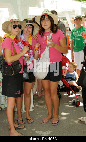 Three attractive young ladies wine tasting at the AOC Saint Chinian Wine Festival in the Languedoc region of southern - Stock Photo
