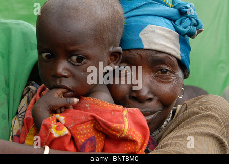 Displaced Congolese woman with a malnourished toddler look dejected in an IDP camp in North Kivu, Congo DR central - Stock Photo