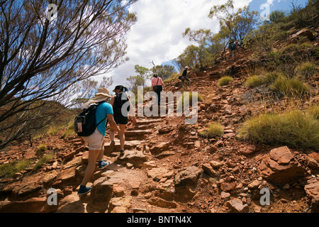 Hikers ascend an escarpment on the Kings Canyon walk. Watarrka (Kings Canyon) National Park, Northern Territory, - Stock Photo