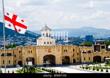 Tbilisi panorama with georgian flag - Stock Photo