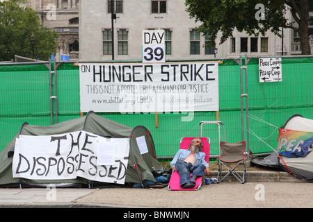 A protester on hunger strike at the peace camp, Parliament Square, Westminster, London, England, U.K. - Stock Photo