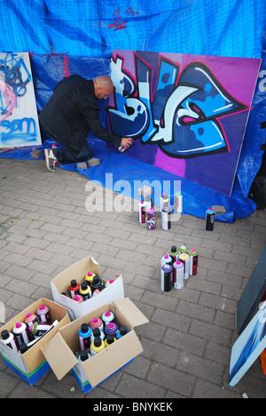 tools and spray cans at graffiti workshop - Stock Photo
