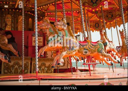 Fairground carousel, on Brighton's seafront - Stock Photo