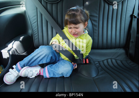Cadiz, Spain; A Young Girl Cries As She Sits In A Vehicle Wearing A Seat Belt - Stock Photo