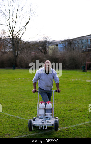 Green Keeper with marking gadget - Stock Photo