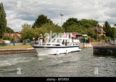 Cabin Cruiser Boat Leaving Hambleden Lock River Thames - Stock Photo