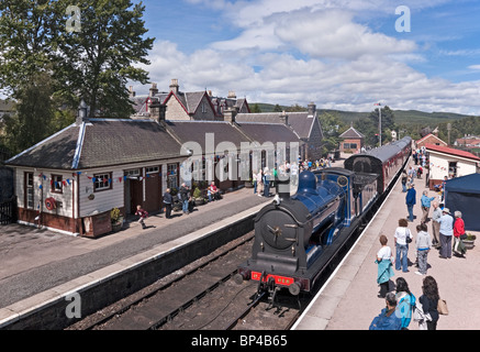 Caledonian Railway restored 0-6-0 steam engine No. 828 arriving at Boat of Garten railway station on the Strathspey - Stock Photo