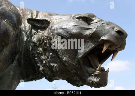 ancient statue of wild ferocious lioness in India - Stock Photo