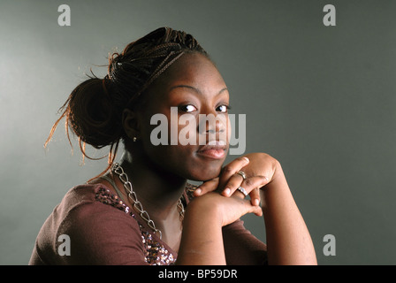 A young high school scholar and track athlete who is working hard to finish high school and continue her education - Stock Photo