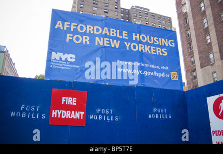 A sign announcing the construction of affordable housing is seen in the the New York neighborhood of Chelsea - Stock Photo