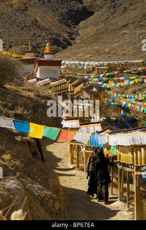 Buddhist devotees walk the kora of Tashilhunpo kora in Shigatse, Tibet - Stock Photo