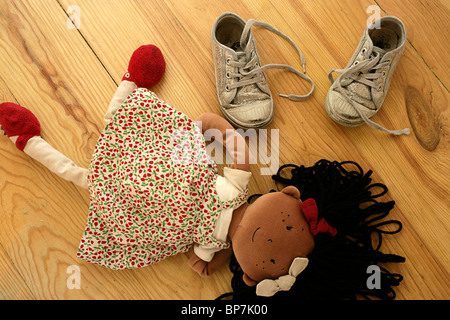 Child's ragdoll and shoes - Stock Photo