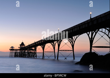 The pier at Clevedon, North Somerset, just after sunset. Clevedon Pier is the only fully intact, Grade 1 listed - Stock Photo
