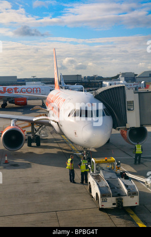 Easyjet aircraft on airfield at London Gatwick Airport, UK - Stock Photo