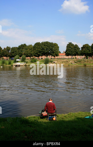 Fisherman on the banks of the River Thames, Surrey - Stock Photo