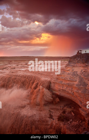 Sunset at Grand Falls or the Little Colorado River, summer thunderstorm in background, Navajo Nation, Arizona, USA - Stock Photo