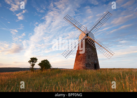 Halnaker windmill standing high up on the South Downs surrounded by the beautiful Sussex countryside on a warm summers - Stock Photo