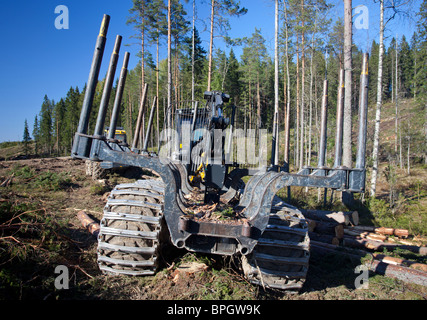 Ponsse Buffalo forwarder forestry vehicle trailer at clear-cutting area , Finland - Stock Photo