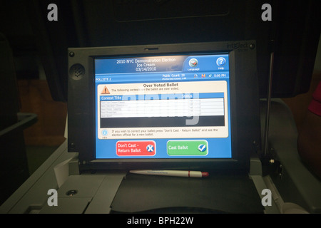 The NYC Board of Elections demonstrates an electronic voting machine - Stock Photo