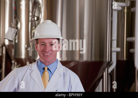 Scientist smiling in a brewery - Stock Photo