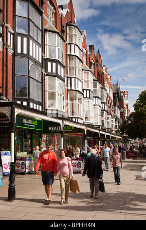 UK, England, Merseyside, Southport, Lord Street, shoppers on broad pavement in sunshine - Stock Photo