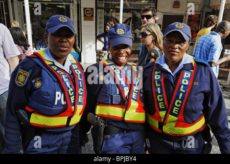 Three police women in uniform, Football world cup final draw, 04.12.2009, fans celebrate the drawing of the first - Stock Photo