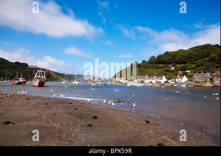 Fishguard harbour as tide goes out in Pembrokeshire, West Wales,Uk. - Stock Photo