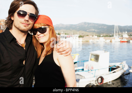Couple in front of harbor - Stock Photo
