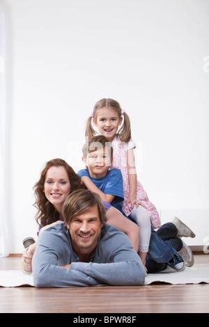 Happy family on rug - Stock Photo