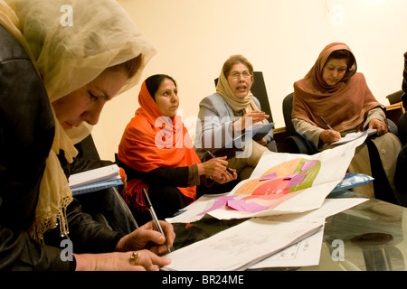 Women in Kabul attend a business training seminar. - Stock Photo