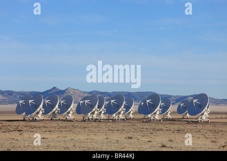 Radio telescope dishes in the Very Large Array, New Mexico, are arranged in the 'D' configuration. - Stock Photo