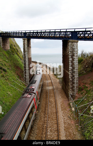 Train Carriages under Bridge at Teignmouth - Stock Photo