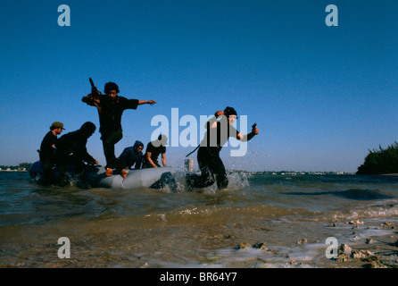 Members of a US paramilitary group practice a beach landing Florida. - Stock Photo