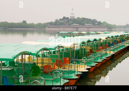 Paddle boats on a lake in Beihai Park Beijing - Stock Photo