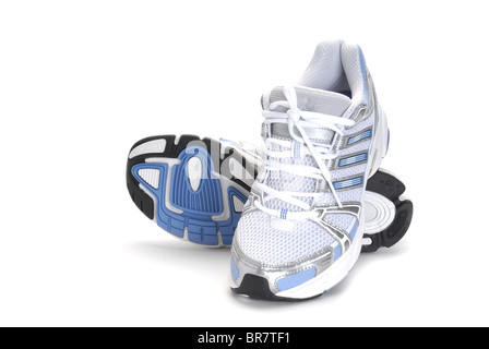 Image of a sport shoes studio isolated on white background - Stock Photo