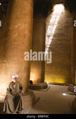 beams of sunlight strike the interior of the well preserved Horus Temple in Upper Egypt - Stock Photo