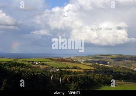 Cumulonimbus cloud and rainbow, Cardigan Bay, St Dogmaels, River Teifi, Pembrokeshire, Wales, United Kingdom - Stock Photo
