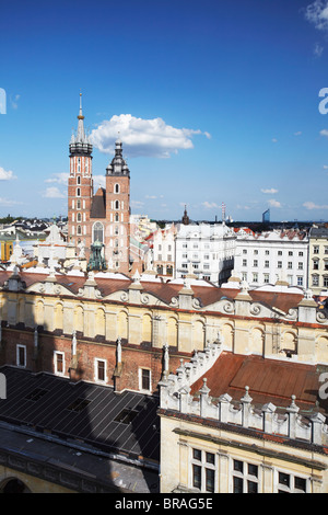 View of St. Mary's Church and Cloth Hall (Sukiennice), UNESCO World Heritage Site, Krakow, Poland, Europe - Stock Photo