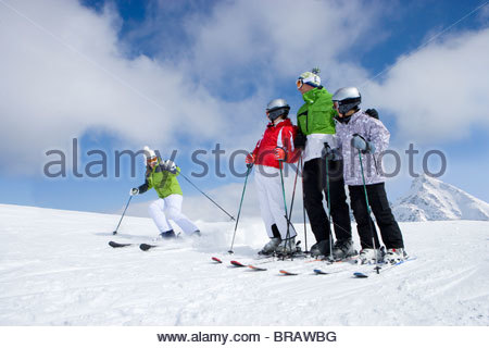 Family skiing on mountain top - Stock Photo