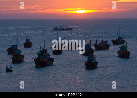 Fishing boats at sunset in habour in the port Mui Ne, Vietnam, Indochina, Southeast Asia, Asia - Stock Photo