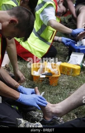 First aid for feet, traditionalist Catholic pilgrimage, Les Bordes, Yvelines, France - Stock Photo