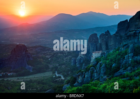 The Roussano & St Nicholas Monasteries Amongst the Spectacular Meteora Mountains at Sunset, Meteora, Plain of Thessaly, - Stock Photo
