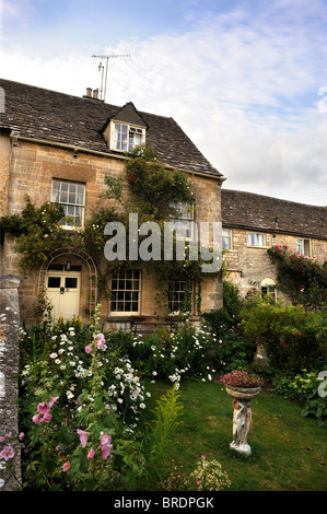 Exterior of a Cotswold cottage Gloucestershire UK - Stock Photo