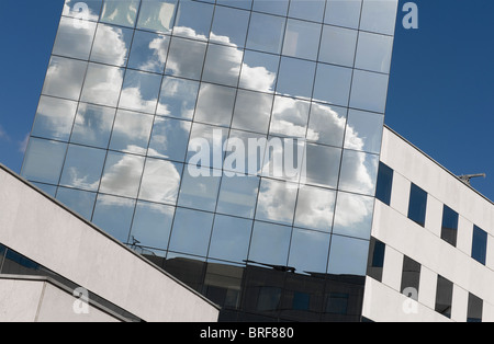 clouds reflected in modern glass building, lille, france - Stock Photo