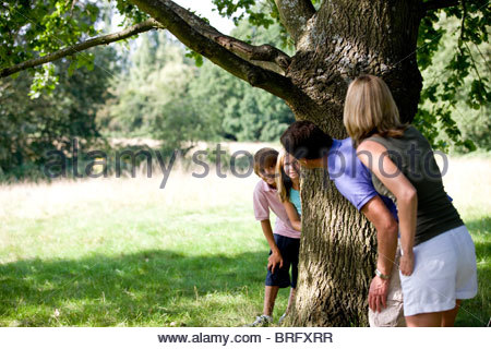 A family playing hide and seek - Stock Photo