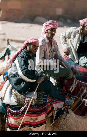 Bedouin camel riders, Petra, Jordan. - Stock Photo
